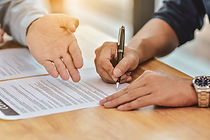 close-up-hand-holding-pen-sign-contract-