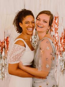 lesbian couple wearing wedding dresses