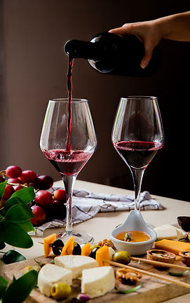 side-view-woman-hand-pouring-red-wine-in