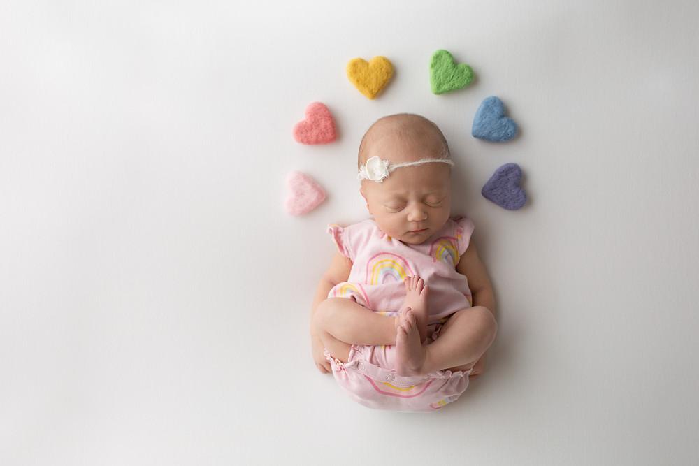 rainbow baby newborn girl with hearts