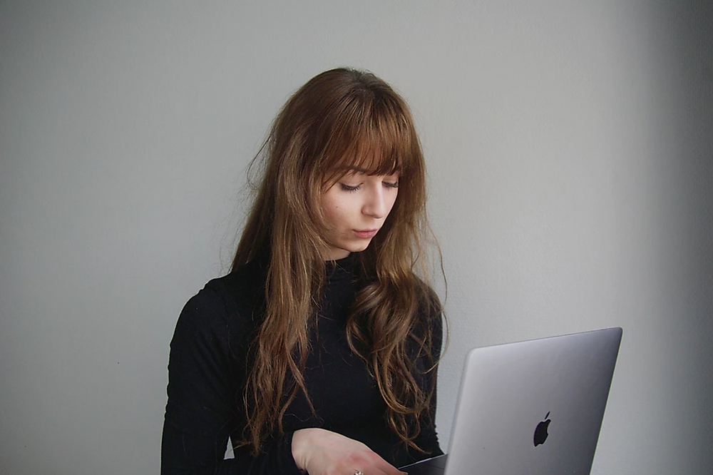 woman planning facebook paid ads
