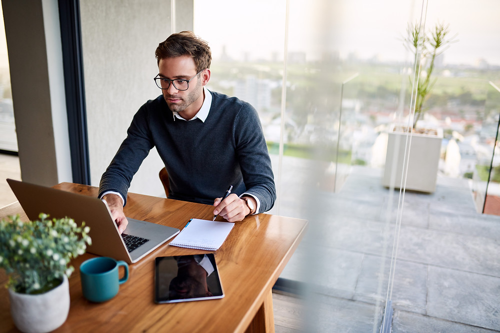 young businessman working on SEO and SEA of new website on laptop