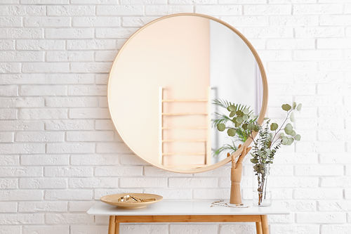 Big round mirror, table with jewelry and