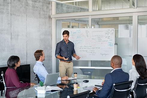 Company executive presenting new managem