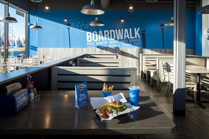boardwalk burgers fries shakes restaurant with table of fast food