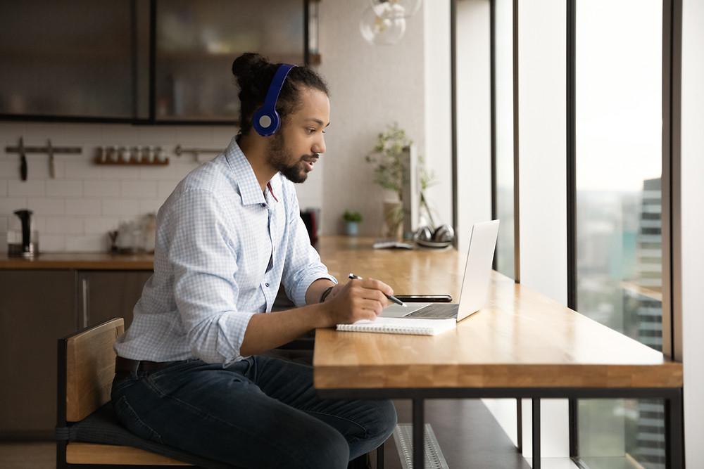 millennial man on laptop doing a presentation
