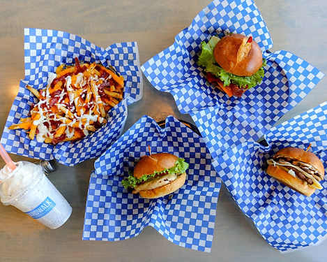 boardwalk burgers fries shakes flatlay of fast food