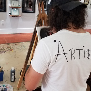 """""""Artist"""" Carlos Gandia banging out some outsider art"""