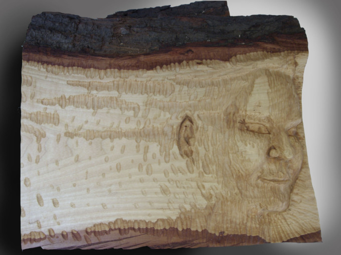 I seem to like making faces in natural things ... carved lime wood, by yours truly!