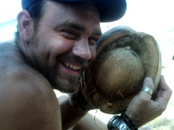 Dunc ... enjoying his first coconut!