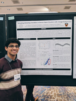 Atirath stands in front of his scientific poster