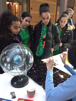 Astronomy demo for young girls at Prince