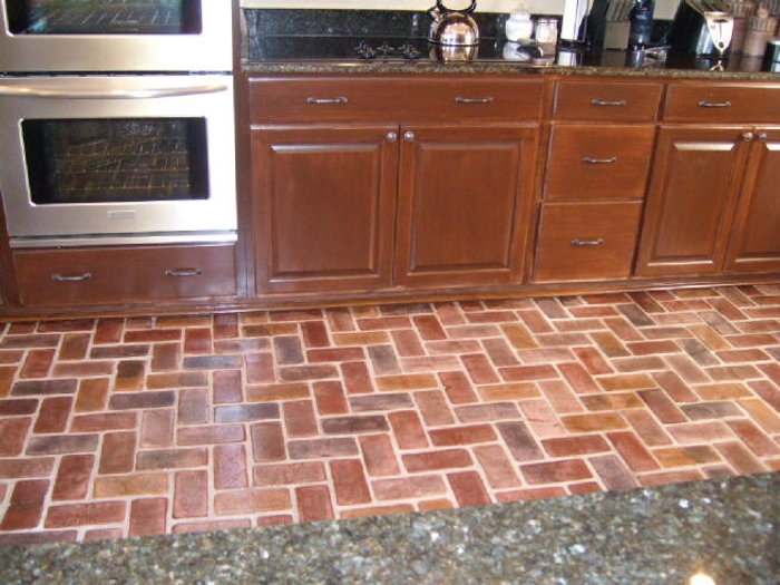 Kitchen with a Charleston brick floor by PortStone.  thin brick on a floor.  Kitchens with brick flooring.  herringbone brick pattern in a kitchen.