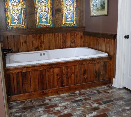 Brick floors in a bathroom.  Stined glass windows in a bathroom.  Cypress wood on a whirlpool tub surround.  PortStone thin brick on a batroom floor.