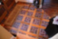 Pinwheel brick pattern. Brick and wood inlaid floor in a foyer. Cypress wood floors.   PortStone thin brick, brick on mesh, thin brick panels, portstone brick panels, Baton Rouge thin brick color.