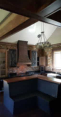 PortStone Thin Brick, New Castle brick color.  Beautiful brick walls in a kitchen.