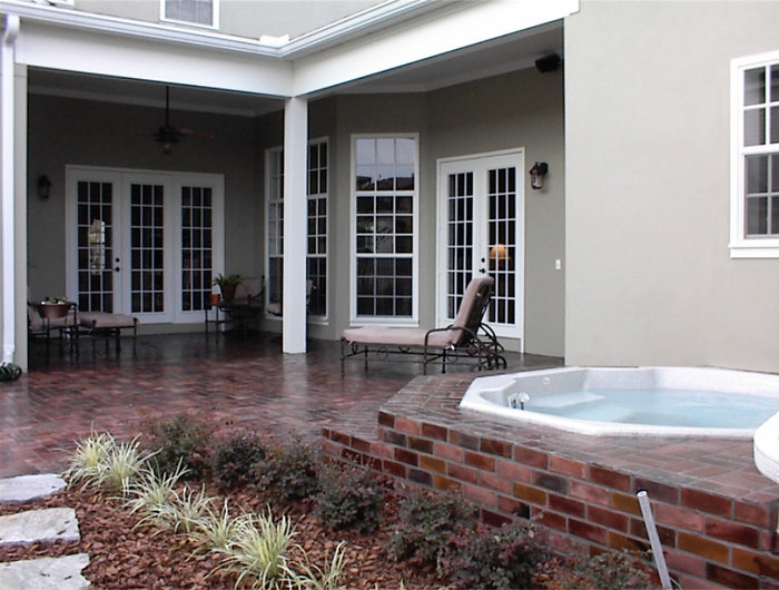 Charleston brick color. Brick around a hot tub. brick patio. PortStone thin brick, herringbone brick pattern