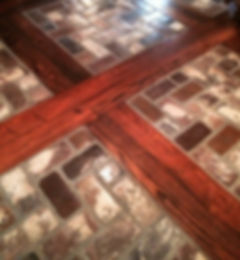 Wood inlay brick floors.  Brick floo with an antique pine inlaid pattern.  Old St. Louis brick by PortStone.  Brick floors ina foyer.  Wood and brick flooring in a foyer.