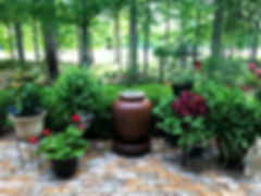 Brick patio.  BrickPorch.  Beautiful back yard. New Castle brick color.  Brick flooring.  Thin brick flooring.  Brown brick color.  PortStone thin brick. Porch overlooking a golf course. Flowers and plants on a brick patio.