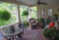 Outdoor living.  exterior design.  Baton Rouge thin brick color by PortStone.  Brick porch.  COvered back porch.  Patio furniture.  Herringbone brick pattern.