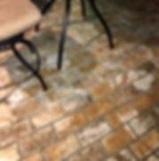 New Castle brick color.  Brick patio.  thin bricks on a patio, patio furniture on a brick floor. PortStone thin brick panels. PortStone thin brick sheets.  Brown and gold bricks.