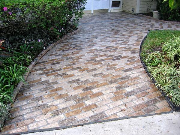 Front brick walkway.  Thin brick on an entry way. Autumn Brown brick color. Brick flooring. Brick floors. Thin brick on a side walk.