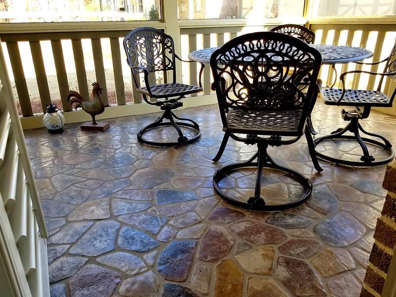 Flagstone in a back porch.  Sunrooom ith a flagstone floor. Pickett's Mill flagstone color. Beatiful screened in back porch with PortStone flagstone flooring.