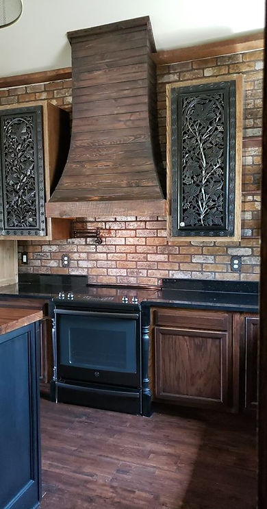 Thin Brick by PortStone makes a beautiful brck wall in a kitchen.