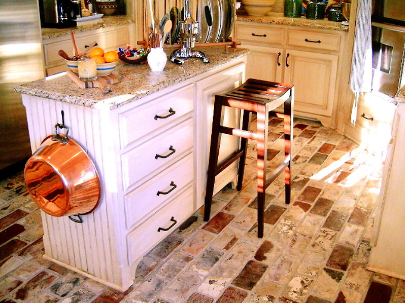 St. Louis thin brick floor in a kitchen. PortStone thin brick.  Runningbond brick pattern.