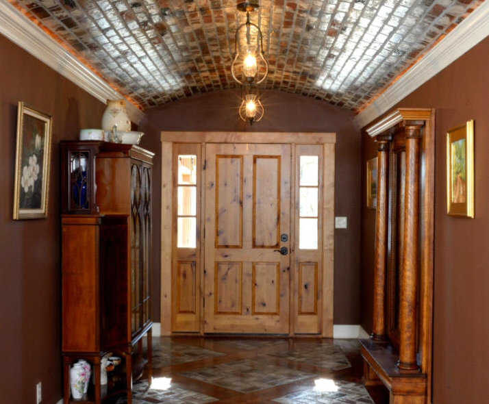 brick ceiling. barrel vault ceiling. PortStoe brick on a ceiling, foyer with a brick ceiling, brick flooring, wood inlay in a brick floor,