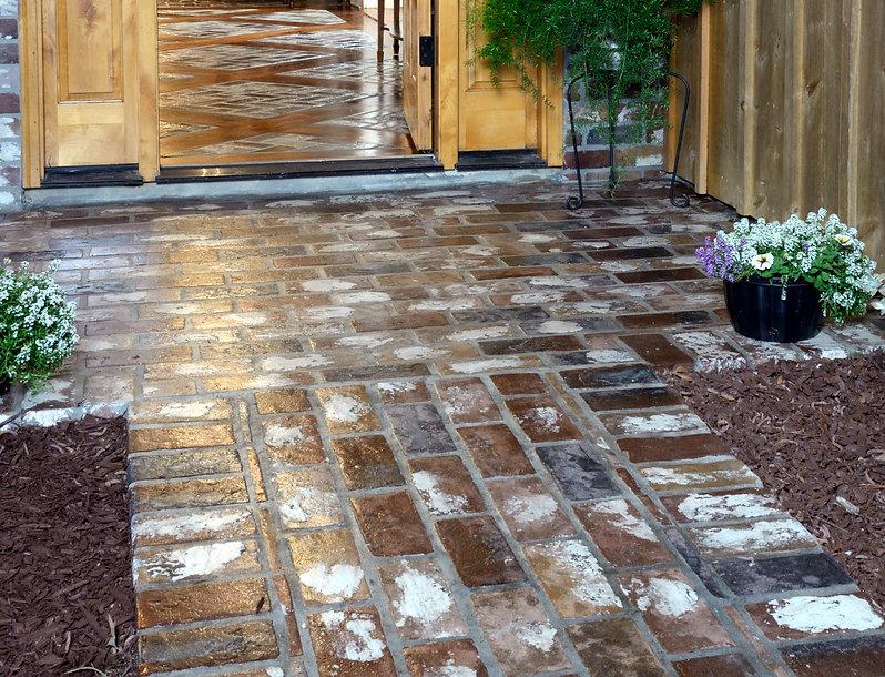 PortStone thin brick on a front walk.  Brick porch.  St. Louis brick color. Soldier course border.  Old brick look.  Wood inlay in a brick floor.  Brick flooring.