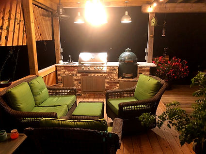 Thin brick on a cooking center.  Green Egg cooking table.  Gas grill on brick cooking center. PortStone thin brick.  Rose Hill brick color.  Brick cooking center on a wood deck.  Outdoor living space.  Outdoor kitchen.  Brick outdoor kitchen.