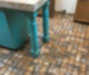 New Castle brick color, herringbone brick pattern on a kitchen floor.  PortStone thin brick flooring, kitchen Island on a brick floor.