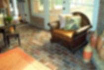 Brick flooring in a sunroom.  Windsr brick color.  running bond brick patten.  PortStone thin bricks in a sunroom.