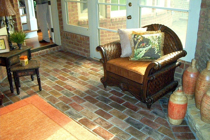 Brick flooring in a sunroom.  Windsr brick color.  running bond brick patten.  PortStone thin bricks in a sunroom.