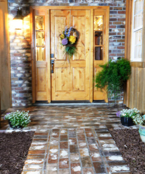 Front porch with PortStone thin brick.  St. Louis on a front porch.  Rose Hill front porch wall.  Knotty alder front door.