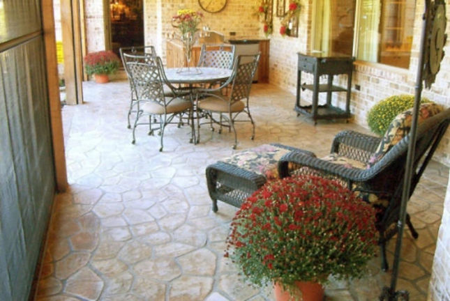 Flagstone on  back porch.  Flagstone n a patio.  Thin stone panel on a patio.  Sandstone colored flagstone.