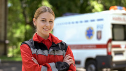 Friendly female paramedic posing for cam