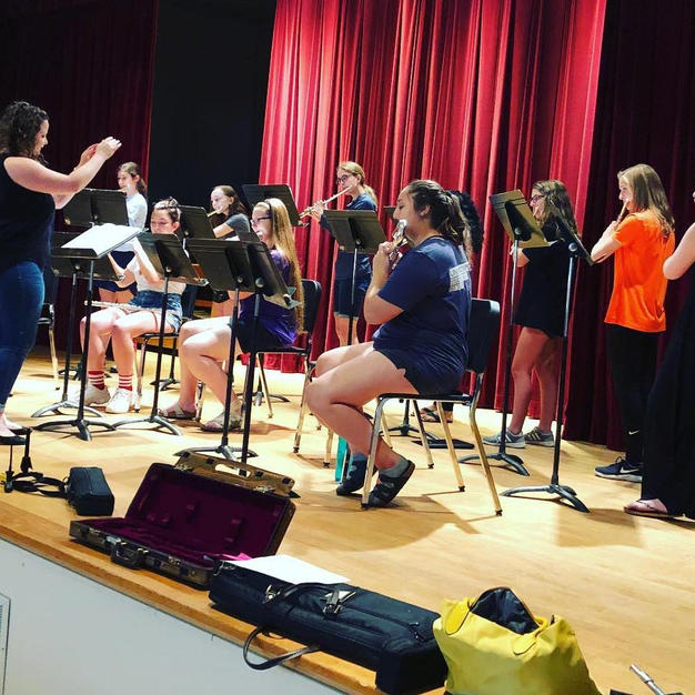 Rose conducting the Coe College Youth Flute Ensemble. July, 2019