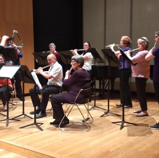 Conducting the Iowa City Flute Choir. June, 2019