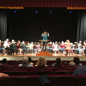Rose conducting at the Eastern Iowa Flute Workshop. September, 2019