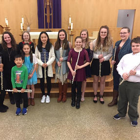 With her private flute students after their recital. January 2018