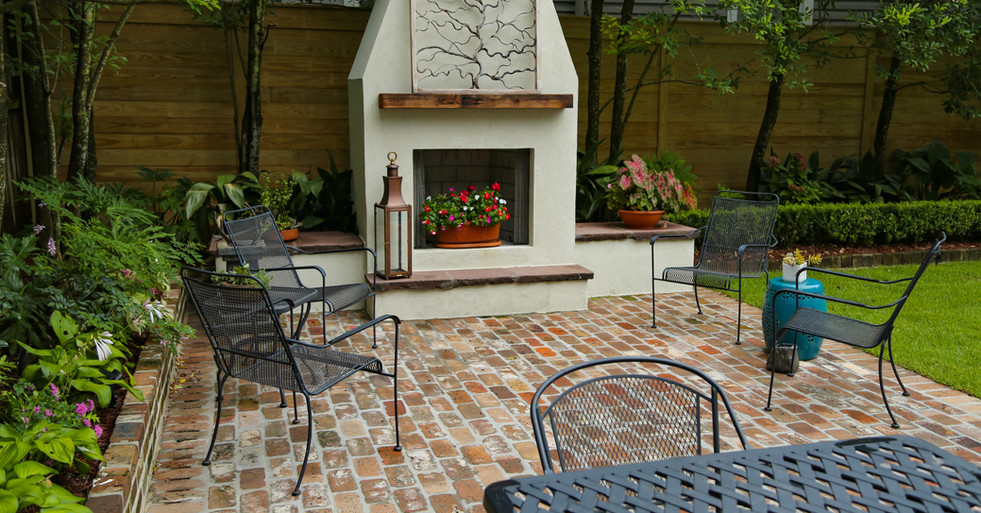 Brick Patio Hardscaping and Outdoor Fireplace with Landscape Design