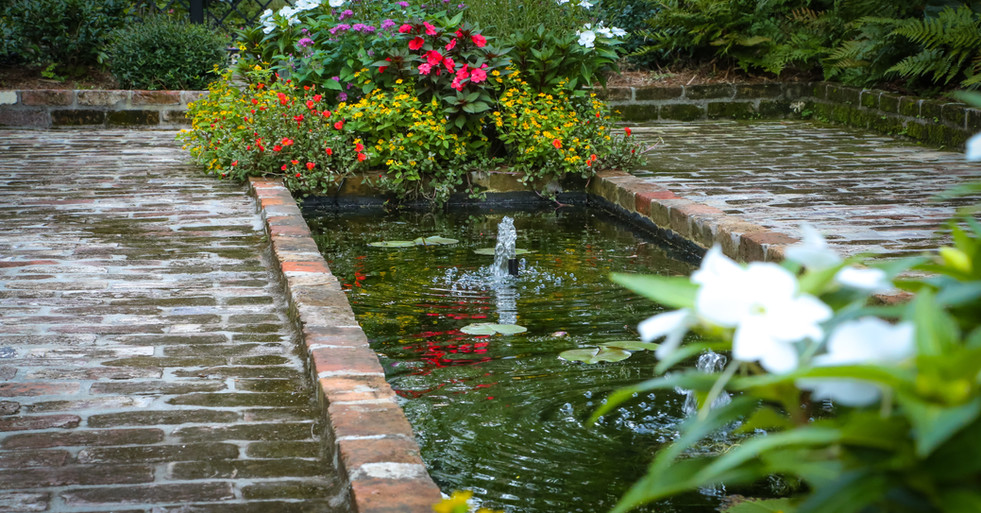 Garden Design with Water Feature and Brick Hardscaping
