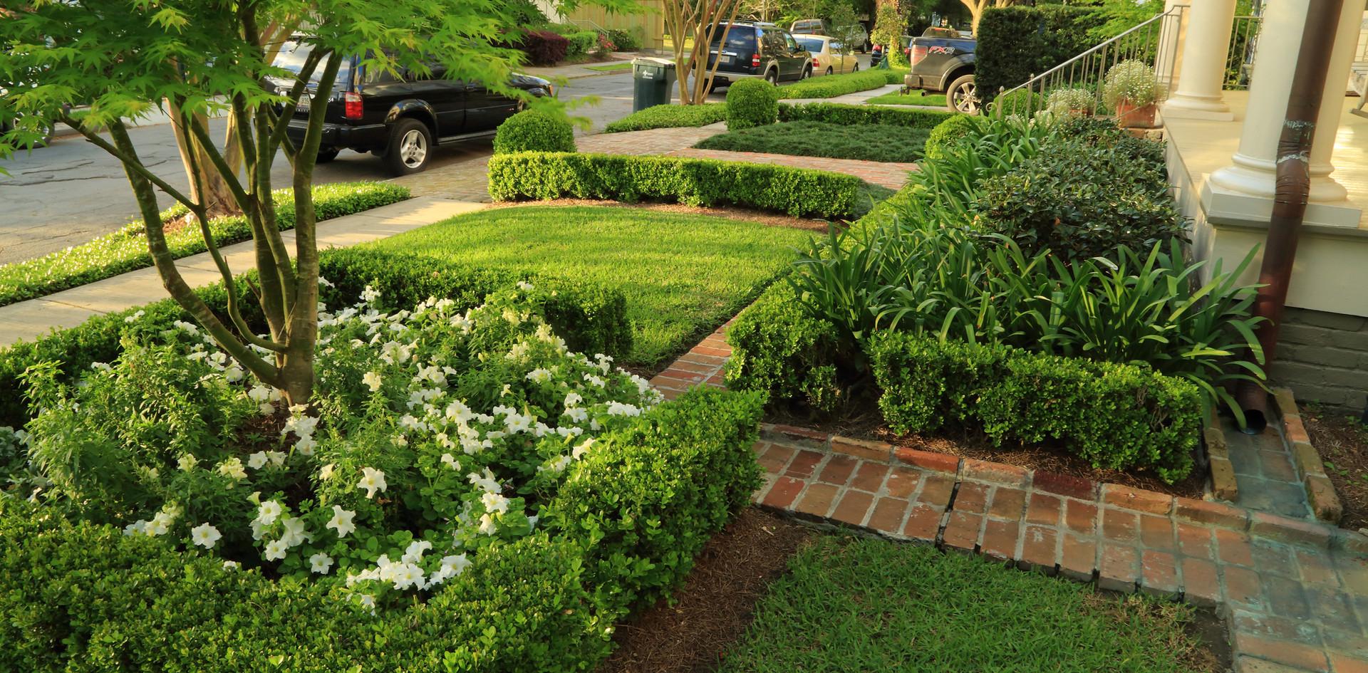 Landscape Installation including Hardscaping Hedges and Flowerbeds