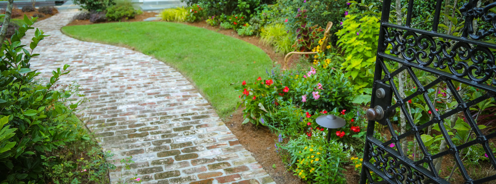 Garden Entrance Planting Design with Brick Hardscaping Pathway