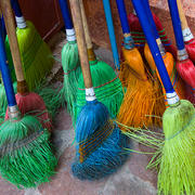 Betsy Pinover Schiff, Colored Brooms, 11.5x  17 photograph