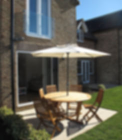 Outside area at Kittiwake Cottage Filey on the Bay resort near the beach.