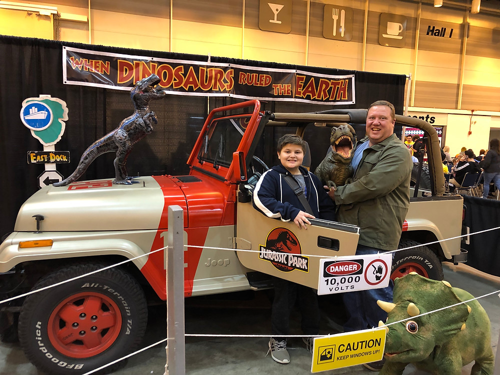 the dinosaur experience from Watson Louisiana brings their baby dinosaur to look at the Jurassic Park Jeep
