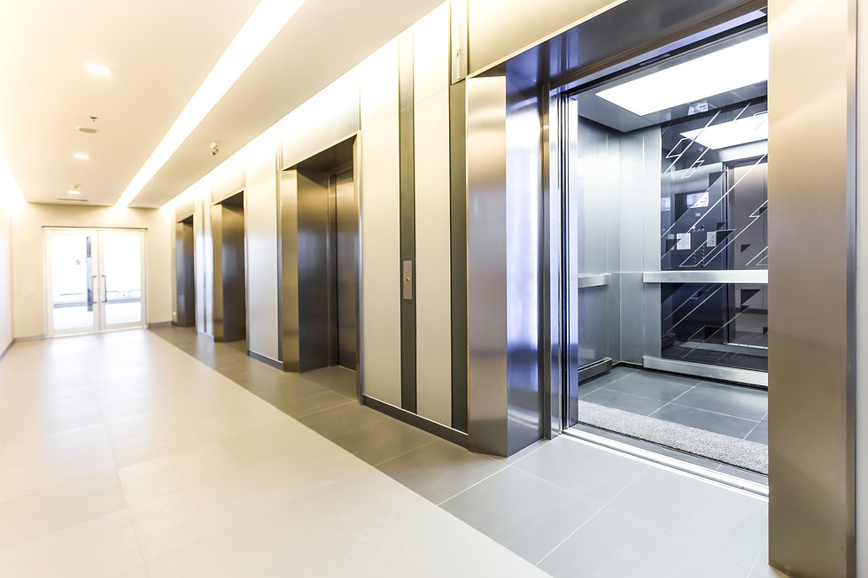 Modern steel elevator cabins in a busine